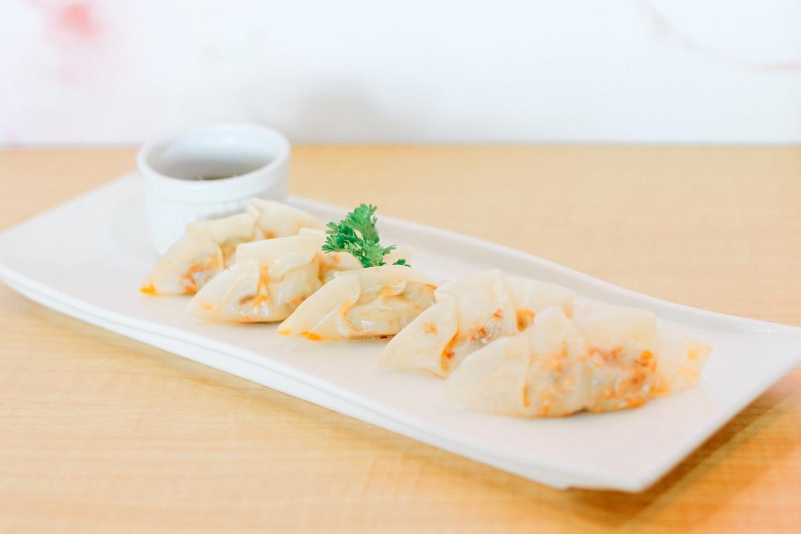 Sisig Dumplings with Plum Sauce